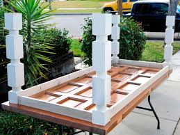 old doors made into coffee tables how to build a dining table from an old door and posts hgtv