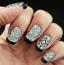 black and white peek a boo stamped nail art design