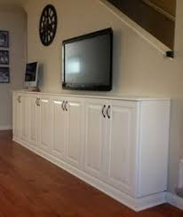 wall cabinets on floor using upper cabinets for the base of built in bookcases what a