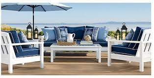 white patio furniture with blue cushions classic cape cod look