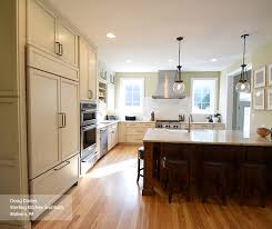 kitchen with black island and white cabinets glazed kitchen cabinets masterbrand