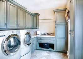 design ideas charming laundry room cabinets with beige countertop