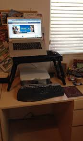 how i turned my sitting desk into a standing desk for less than