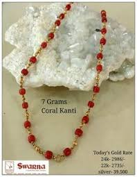 coral with light weight gold balls coral cylindrical