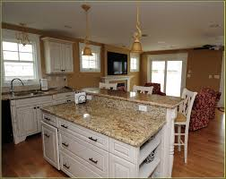travertine countertops distressed white kitchen cabinets lighting