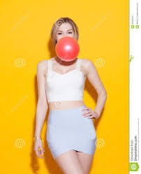 fashionable modern posing in colorful top and skirt inflates
