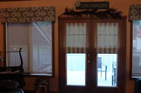 interior roll up window treatment for door hanging on brown