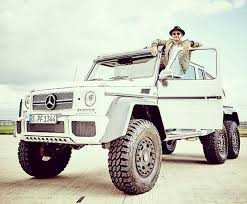 six wheel mercedes suv lewis hamilton poses in lunatic 370 000 mercedes 6x6 up