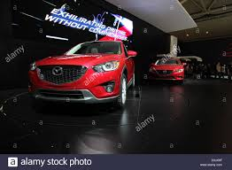 mazda cars red mazda cars stage auto show stock photo royalty free image