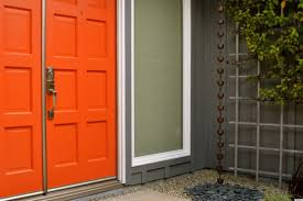 red entrance door with white framed door uses contemporary handle