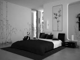 black and white bedding on the black rug plus black wooden side