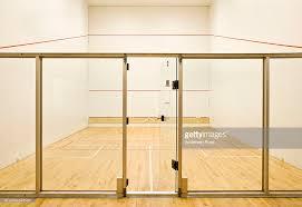entrance glass door glass door entrance onto empty squash court stock photo getty images