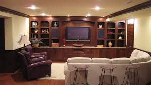 Custom Home Entertainment Center and Cabinetry at Basement traditional home theater