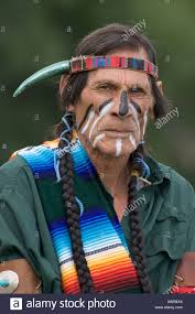 native american man in costume and war paint stock photo royalty