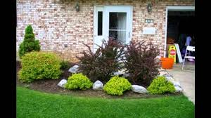 Easy Front Yard Landscaping - simple stone wall of small house has easy front lawn landscaping