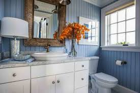 wonderful beach themed bathroom with blue walls and white vanity