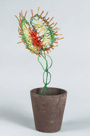 venus fly trap made out of wire growing out of a potted