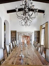 dining table in front of fireplace french dining room features a long plank dining table lined with