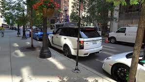gold range rover range rover lumma clr r outside gold coast bentley chicago