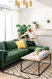 evergreen decor idea green sofa and white interior make a great