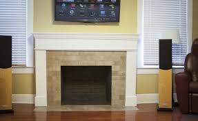 tile over brick fireplace completed