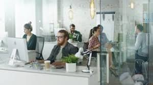 office bureau weekday in a busy creative bureau office working at their