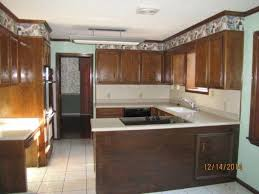 can you reface laminate kitchen cabinets kitchen cabinet refacing using wall paper hometalk