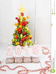 creative fruit christmas tree with different berries fruits and