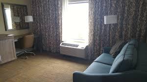 hampton inn guest room living area visit roseville roseville mn