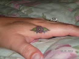 flower tattoo ring 45 flower tattoos on fingers