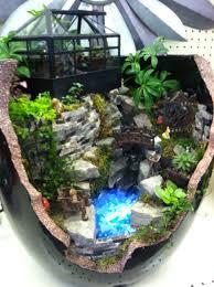 Broken pot fairy garden with water feature design by Kristin