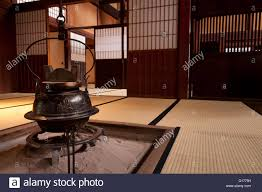 traditional japanese home interior with tea pot over fireplace