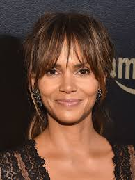 layered hairstyles with bangs and tuck behind the ears growing out bangs gracefully is doable here s how instyle com
