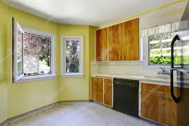 yellow kitchen wood cabinets small kitchen room interior with yellow walls wooden cabinets and tile counter top 123505226
