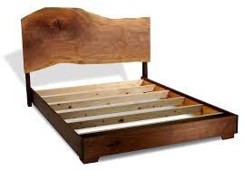 headboard is a single slab of sycamore frame is black walnut