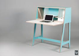 a wired desk that u0027s built into a cabinet design milk