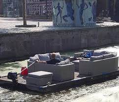 man creates floating living room to travel in style along canals