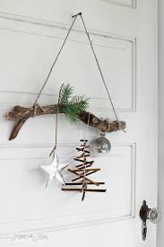 rustic twig christmas tree ornament on a branch twig christmas