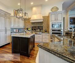 wood kitchen cabinets with white island white cabinets with a wood kitchen island masterbrand