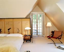 breathtaking attic with king sized bed and asian room divider also