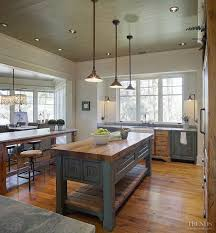 farm table kitchen island the cabinets in this kitchen are pecky cypress were custom built
