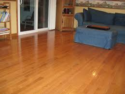 flooring cozy bruce hardwood floors with gray sofa and corner