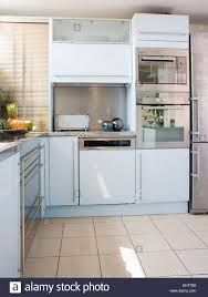 stainless steel oven and fitted dishwasher in modern white
