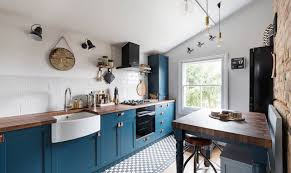 light grey kitchen cabinets with black appliances black kitchen appliances and bold additions for every