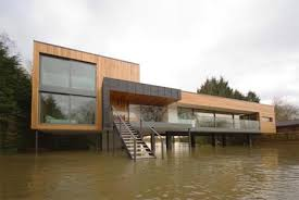 elevated home designs lofted living elevated home literally sits on the water