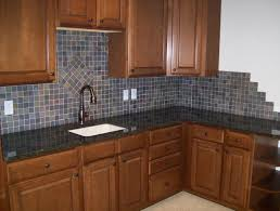 brown solid wood countertop glass window kitchen backsplash ideas