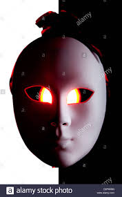scary black and white mask with red eyes stock photo royalty free