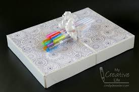book wrapping paper wrapping a gift with a coloring book and pens family crafts