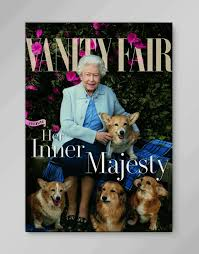 queen elizabeth and her cute corgis are on the cover of vanity fair