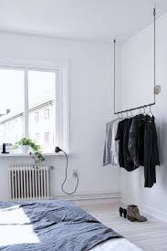Hanging Clothes Rack From Ceiling Best 20 Coat Rail Ideas On Pinterest Wooden Clothes Rack